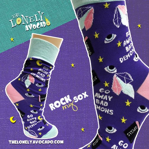 Funky socks that feature crystals, spell books and other demon witchcraft items
