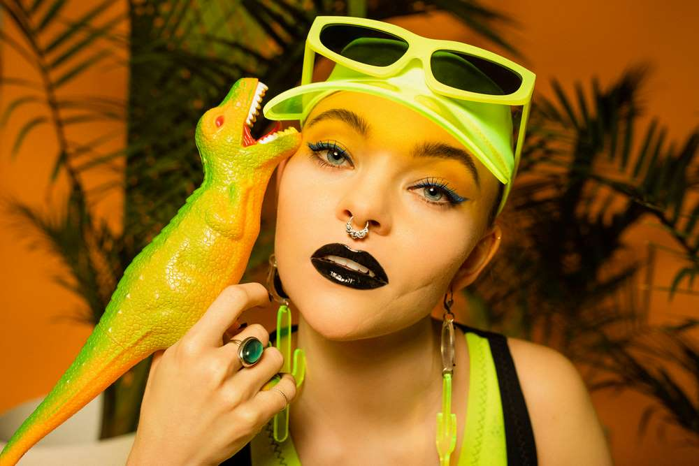 Taylor Hickson in a neon swimsuit