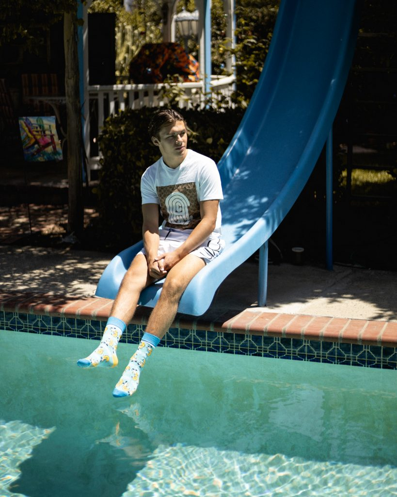 Trenton Negrete Sitting on Slide at Pool