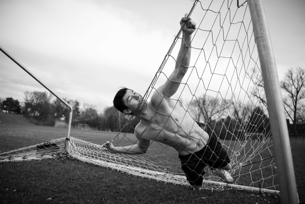 Sports Boys - Shirtless Guy Soccer Field - Laying on Net -Andrew Haan